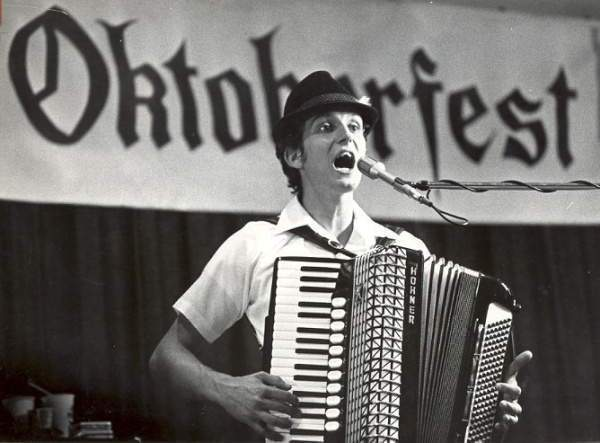 Black and white file photo. Mike Farrenkope on accordian. 4th member of Die Musikanten, a local band. Also in band (not pictured) Martin Farrenkopf (bass), Rick Miller (drums), Bill Rees (trumpet).__Fairs and festivals; Oktoberfest; Octoberfest; man singing; man playing accordian._ _accordion ._Columbus Dispatch Magazine, page 12, 8/31/1986.