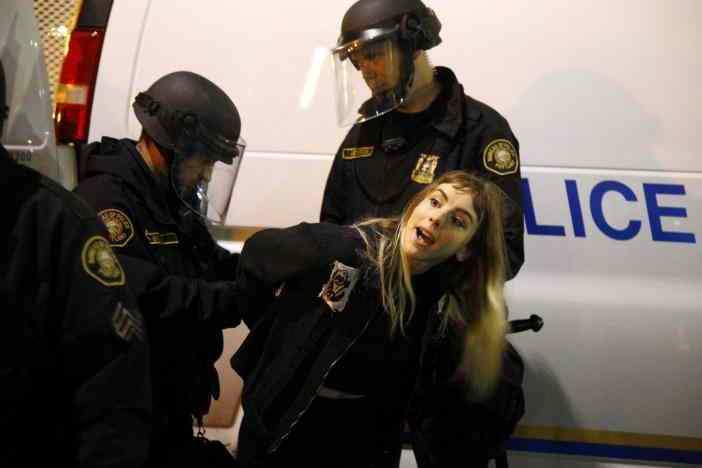 Police detain a demonstrator during a protest against the election of Republican Donald Trump as President of the United States in Portland, Oregon, U.S. November 10, 2016. REUTERS/Steve Dipaola