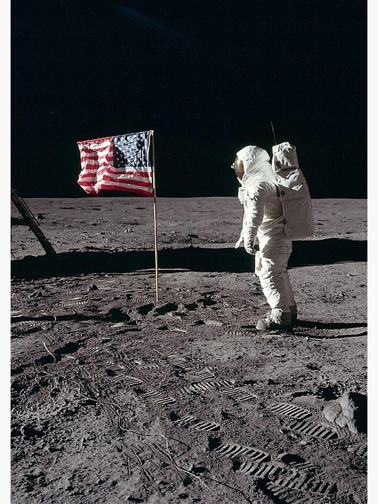 Buzz Aldrin on the moon with the American flag