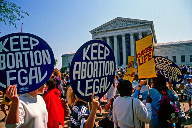 Supporters for and against legal abortion face off during a protest outside the United States Supreme Court Building, Washington